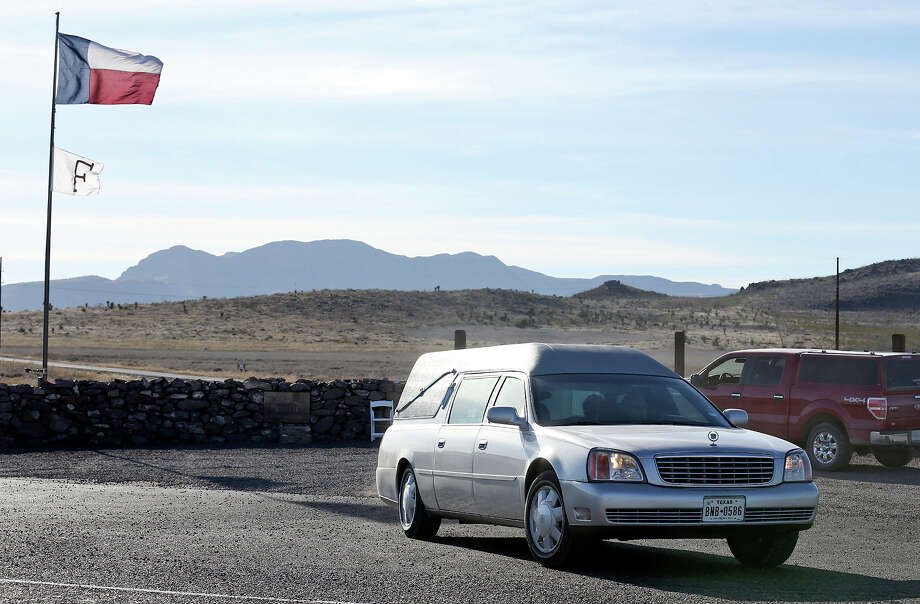 A hearse leaves the Cibolo Creek Ranch Saturday Feb. 13, 2016 on U.S. 67 near Shafter, Tx. Photo: Edward A. Ornelas, San Antonio Express-News / © 2016 San Antonio Express-News