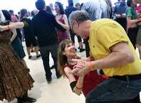 Mary Ann Falzone of Philadelphia, center, takes a dip from dance partner Mike Schwartz of Bloomfield, N.J. during the 29th annual Flurry festival on Saturday, Feb. 13, 2016, at Saratoga Springs City Center in Saratoga Springs, N.Y. The Flurry continues Sunday at various locations from 9 a.m. to 5:30 p.m. For information visit  www.flurryfestival.org . (Cindy Schultz / Times Union)