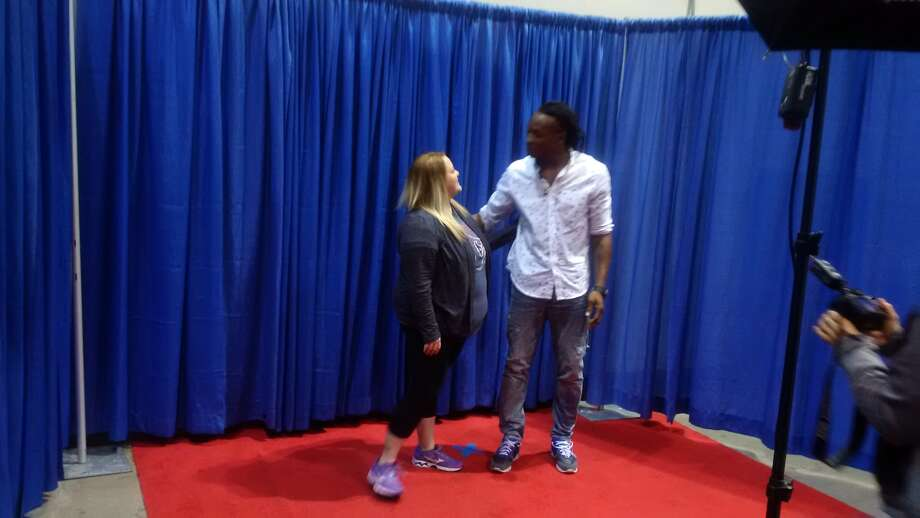 Texans wide receiver DeAndre Hopkins talks with a fan during the 30th annual Houston Collectors Show presented by TriStar Productions on Saturday at NRG Arena. Photo: Aaron Wilson