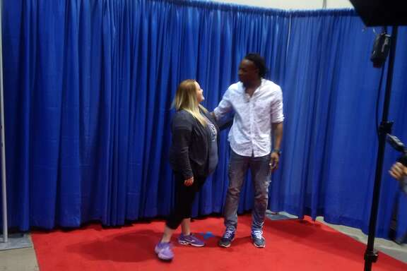 Texans wide receiver DeAndre Hopkins talks with a fan during the 30th annual Houston Collectors Show presented by TriStar Productions on Saturday at NRG Arena.
