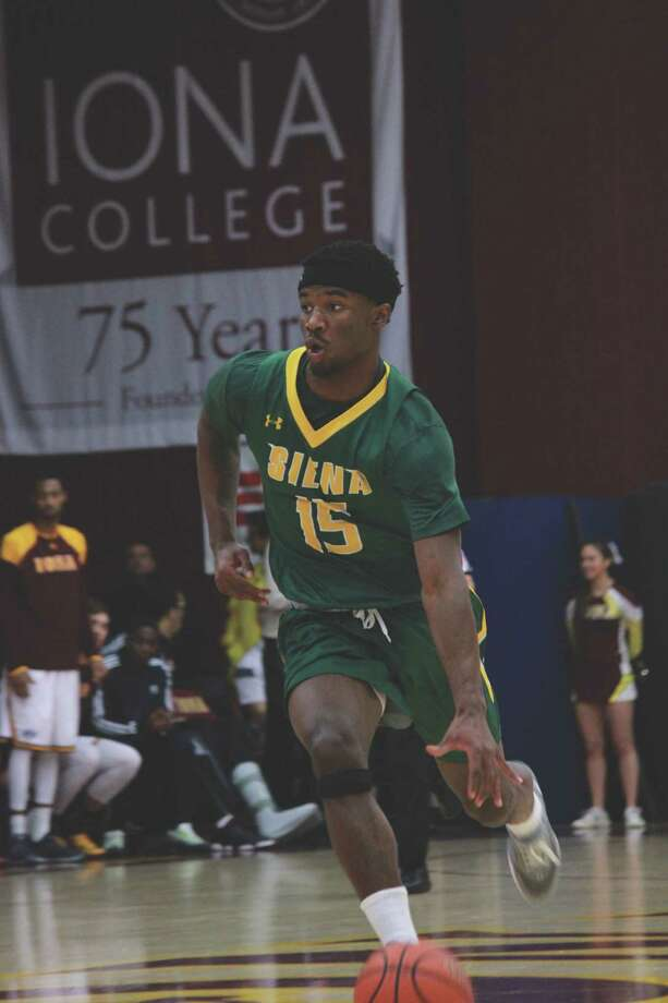 Nico Clareth pushes the ball up the court against Iona on Saturday.