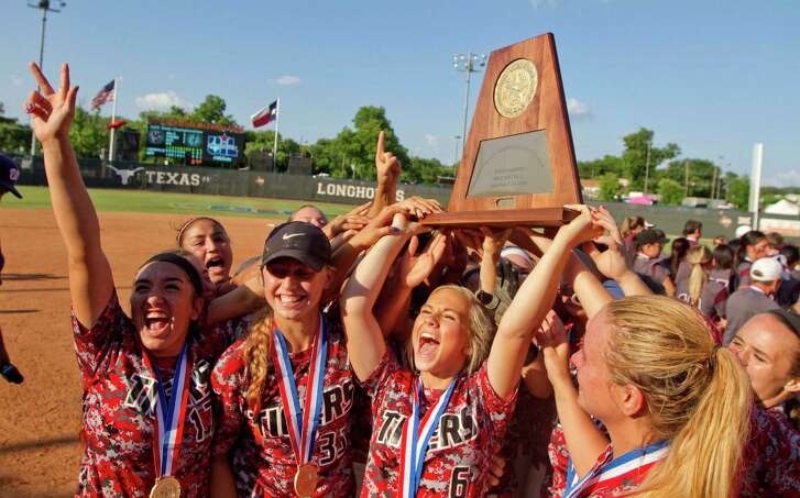 Katy players celebrate last June after capturing the Class 6A softball championship in Austin. Now the trick becomes to repeat. The Tigers return most of last year's team with the intent of doing just that.