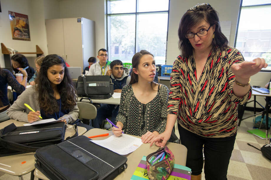 In this file photo, Elizabeth Cerri-Morgan, right, encourages students during her Advanced Placement English III class at Houston ISD's Westside High School in preparation for AP exams. Photo: Cody Duty, Staff / © 2015 Houston Chronicle