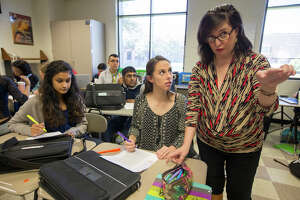 Elizabeth Cerri-Morgan, right, encourages students during her Advanced Placement English III class at Westside High School in preparation for AP exams.