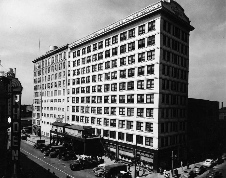 Delivery trucks pull up to the Chronicle's building in 1949 during an era when smoke filled the air and spittoons dotted the newsroom. For some Houstonians, 801 Texas Ave. will forever remain the paper's spiritual home. / Houston Chronicle