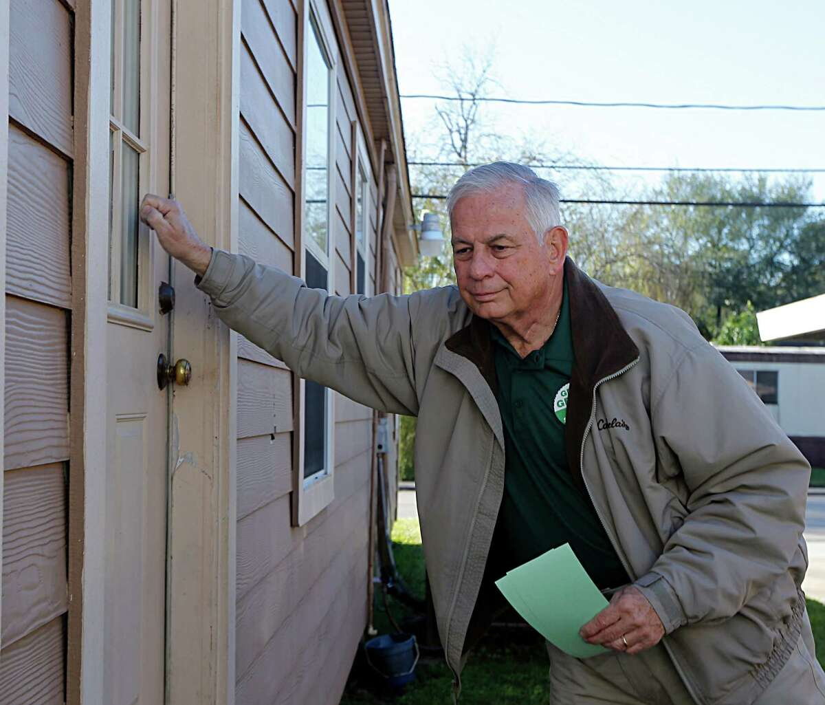 Congressman Gene Green knocks on a door while canvasing voters at their homes Saturday, Jan. 9, 2016, in Pasadena. ( James Nielsen / Houston Chronicle )