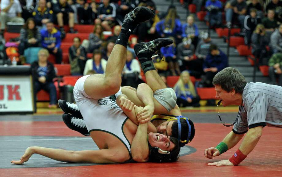 Newtown's Joe Accousti and New Milford's Kyle Fabich wrestle in the 170 pound weight class championship match during the SWC high school wrestling championships, held at Masuk High School, on Saturday, February 13, 2016, in Monroe, Conn. Accoousti won the match. Photo: H John Voorhees III, Hearst Connecticut Media / The News-Times