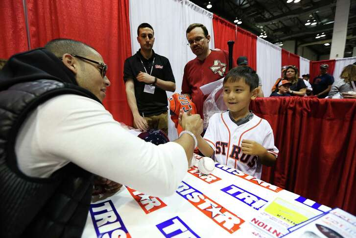 Seven-year-old Juan Tres Vasquez III waited in a long line Saturday at Tristar's Houston Collectors Show at NRG Arena to meet Astros shortstop Carlos Correa.