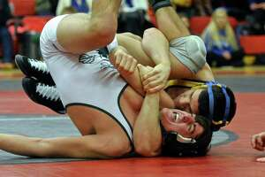 New Milford captures SWC wrestle in dominant fashion - Photo