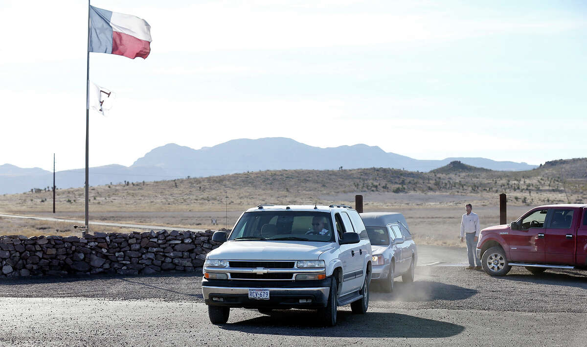 A hearse and a SUV leave the Cibolo Creek Ranch Saturday Feb. 13, 2016 on U.S. 67 near Shafter, Tx.