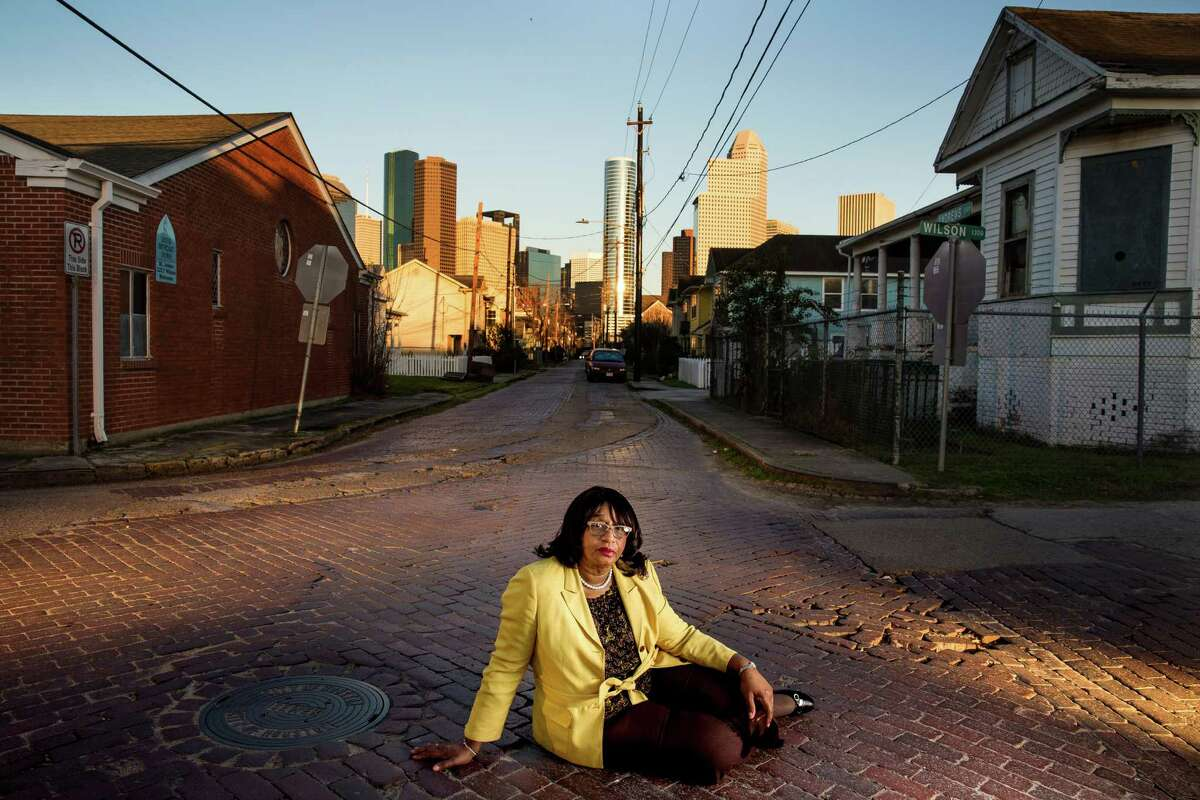 Dorris Ellis Robinson of the Freedmen's Town Preservation Coalition is fighting to keep the area's historic bricks intact.