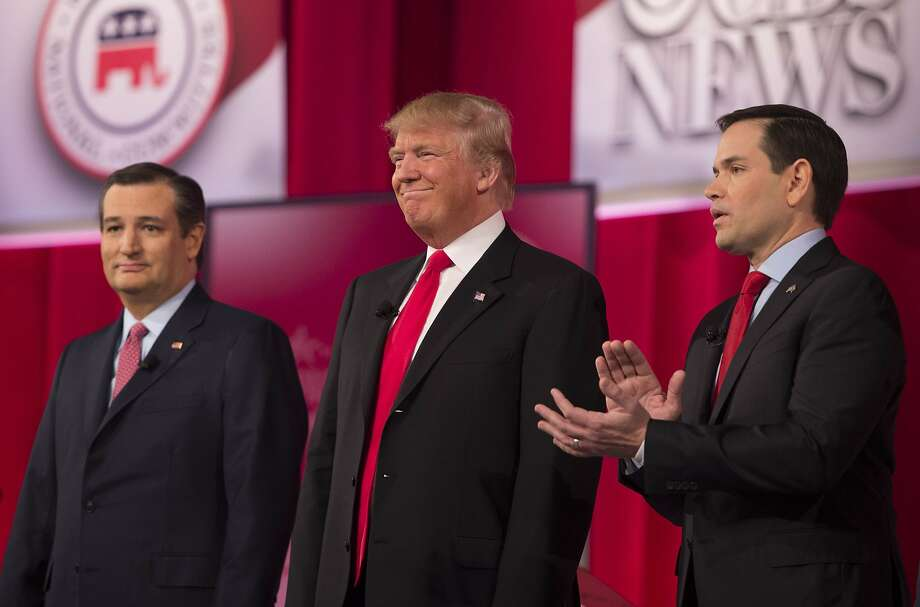 Republican presidential candidates Ted Cruz (left), Donald Trump and Marco Rubio join the debate in Greenville, S.C. Photo: Jim Watson, AFP / Getty Images