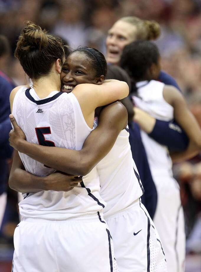 SAN ANTONIO - APRIL 06:  Kalana Greene #32 hugs Caroline Doty #5 of the Connecticut Huskies after a 53-47 win against the Stanford Cardinal during the NCAA Women's Final Four Championship game at the Alamodome on April 6, 2010 in San Antonio, Texas.  (Photo by Ronald Martinez/Getty Images) Photo: Ronald Martinez, Getty Images / 2010 Getty Images