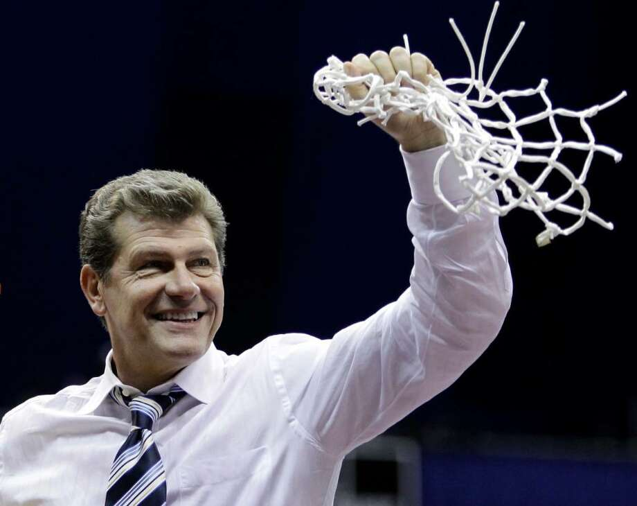Connecticut coach Geno Auriemma grasp the net after cutting it down following the women's NCAA Final Four college basketball championship game against Stanford Tuesday, April 6, 2010, in San Antonio. Connecticut won 53-47. (AP Photo/Eric Gay) Photo: Eric Gay, AP / AP