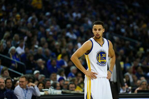 Stephen Curry (30), of the Golden State Warriors during a game against the Miami Heat at Oracle Arena in Oakland, California on Monday, January 11, 2016.