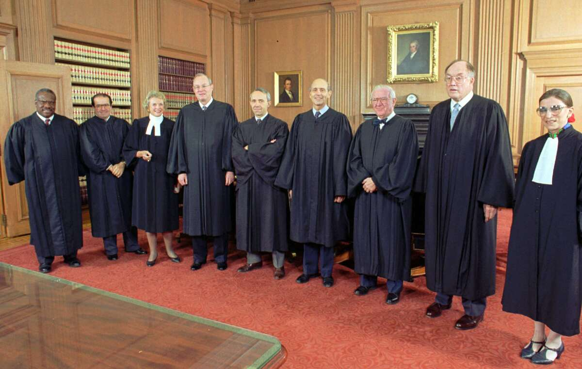 Chief Justice William Rehnquist, second from right, poses with members of the Supreme Court after the investiture of the court's newest member Stephen Breyer Sept. 30, 1994 at the court in Washington. From left are, Associate Justices, Clarence Thomas, Antonin Scalia, Sandra Day O'Connor, Anthony Kennedy, David Souter, Stephen Breyer, John Paul Stevens, Rehnquist, and Ruth Bader Ginsburg.