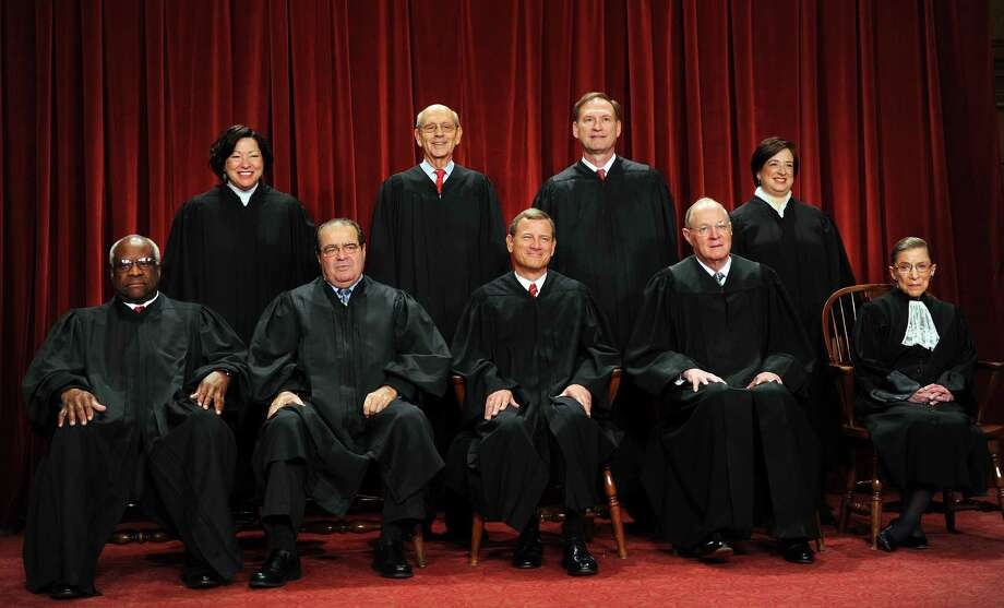 The Justices of the US Supreme Court sit for their official photograph in this October 8, 2010 file photo at the Supreme Court in Washington, DC. Photo: TIM SLOAN /AFP /Getty Images / AFP ImageForum