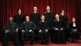 The Justices of the US Supreme Court sit for their official photograph in this October 8, 2010 file photo at the Supreme Court in Washington, DC.