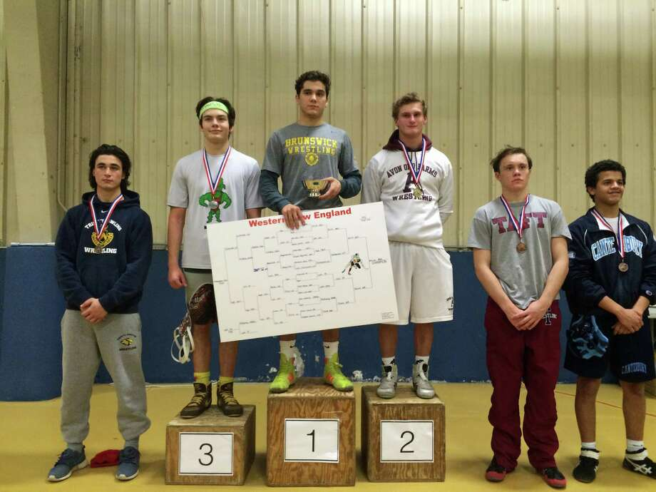 Jon Errico of Brunswick, center, won the 152-pound class title at the WNEISWA Championships on Saturday. He was named the Most Outstanding Wrestler and earned a trophy for recording the most pins in the least amount of time. Photo: Contributed Photo / Contributed Photo / Greenwich Time Contributed