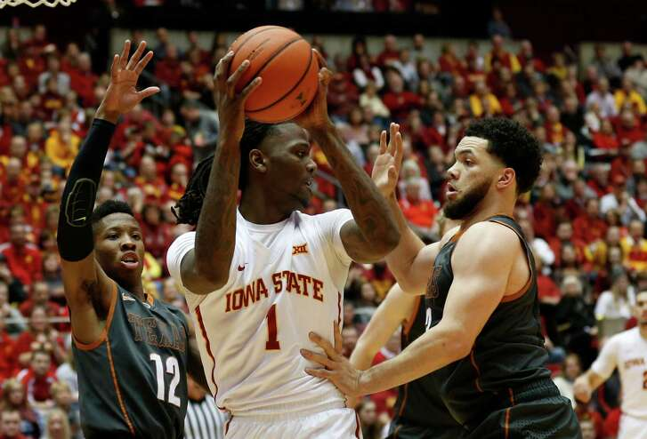 AMES, IA - FEBRUARY 13: Jameel McKay #1 of the Iowa State Cyclones looks to pass the ball as Kerwin Roach Jr. #12, and Javan Felix #3 of the Texas Longhorns put pressure on in the first half of play at Hilton Coliseum on February 13, 2016 in Ames, Iowa. (Photo by David Purdy/Getty Images)