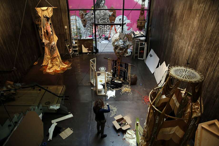 Caledonia Curry, aka Swoon, works on part of her art installation at Chandran Gallery in San Francisco, California, on Thursday, Feb. 11, 2016. Photo: Connor Radnovich, The Chronicle