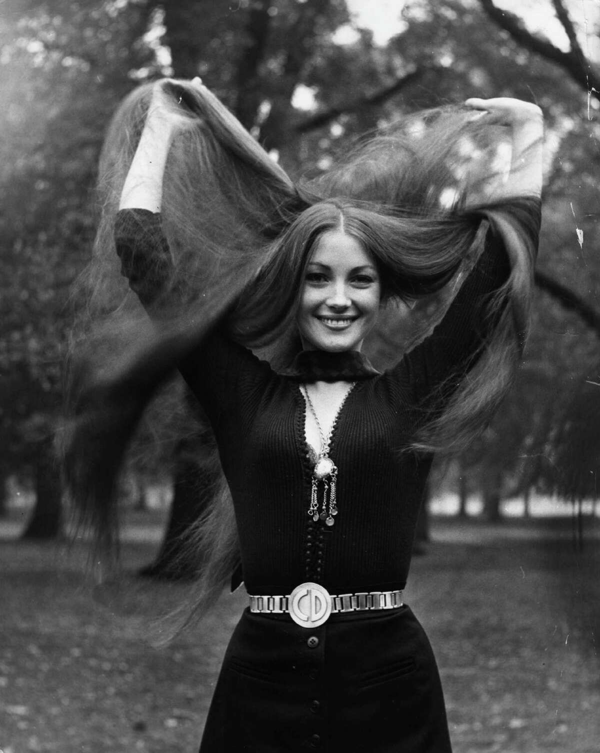 1972: Seymour shows off her signature long tresses in a London park.