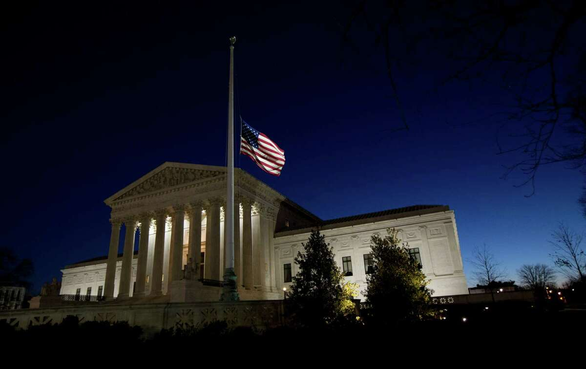 An American flag flies at half-staff in front of the U.S. Supreme Court building in honor of Supreme Court Justice Antonin Scalia as the sun rises in Washington, Sunday, Feb. 14, 2016. Scalia, the influential conservative and most provocative member of the Supreme Court, has died. He was 79.