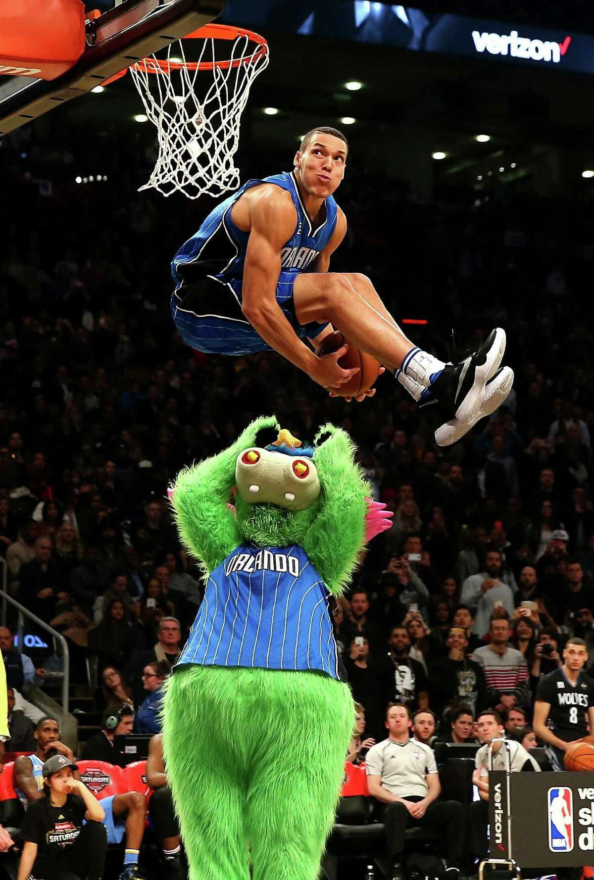 TORONTO, ON - FEBRUARY 13: Aaron Gordon of the Orlando Magic dunks over Stuff the Orlando Magic mascot in the Verizon Slam Dunk Contest during NBA All-Star Weekend 2016 at Air Canada Centre on February 13, 2016 in Toronto, Canada. NOTE TO USER: User expressly acknowledges and agrees that, by downloading and/or using this Photograph, user is consenting to the terms and conditions of the Getty Images License Agreement.