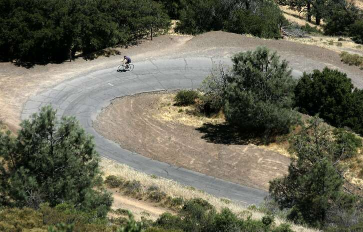 Bicyclist Haun Saussy (cq) of SF rides on Summit Road near the summit on a corner called the Devil's Elbow.   The Mount Diablo State Park's popular Summit Road will be closed for much of the rest of the summer for repairs. Some of the work may close the popular road and the mountain's 3,849-foot summit to both bikes and cars. Contractors will be repaving roads and repairing failing culverts which divert rain-water from the road. This $2.4 million project will take place along the 4.5 mile-long Summit Road. Crews also will do some repairs on North Gate Road the parkÕs entrance from Walnut Creek. Photo by Michael Maloney / San Francisco Chronicle on 7/10/06 in Mt Diablo,CA **   Haun Saussy 415 609-0822