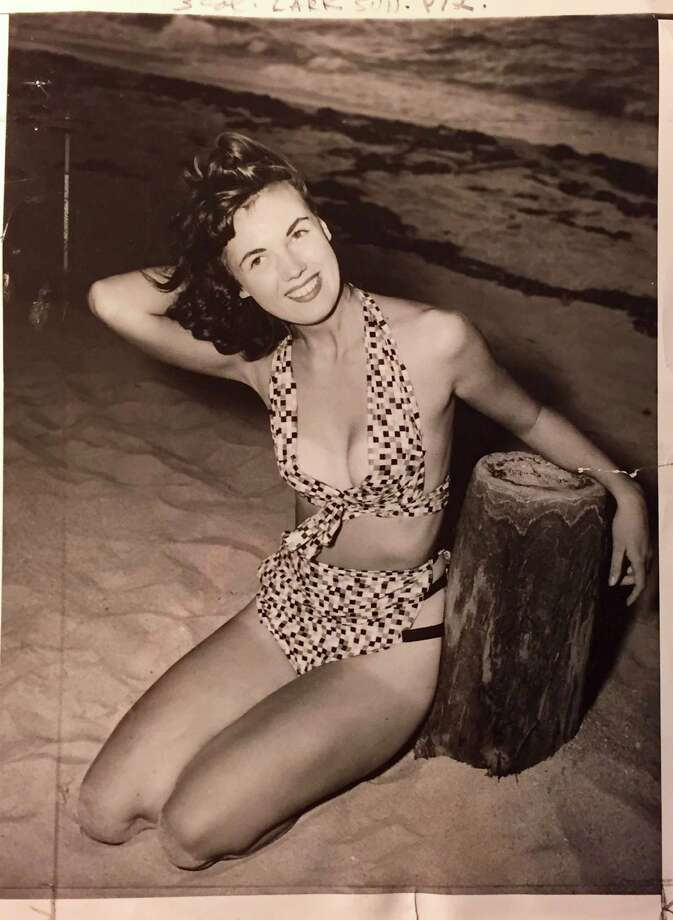 1949 info with photo: Bikini bathing suits are strictly second-rate stuff when you compare them with two of the latest creations of Bunny Yeager, who is shown doing her own modeling here. Photo: PI File