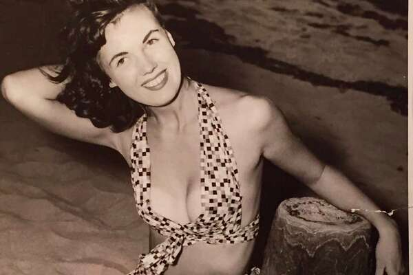 1949 info with photo: Bikini bathing suits are strictly second-rate stuff when you compare them with two of the latest creations of Bunny Yeager, who is shown doing her own modeling here.