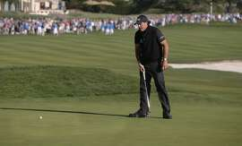 Phil Mickelson with a chance to force a playoff misses his birdie putt on the 18th hole as Vaughn Taylor wins the AT&T Pebble Beach Pro-Am on Sun. February 14, 2016, in Pebble Beach, California.
