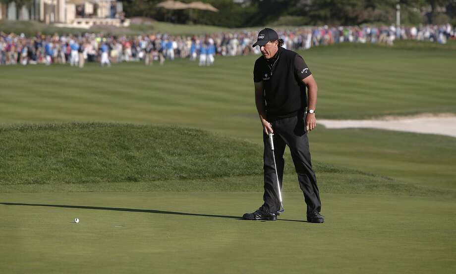 Phil Mickelson with a chance to force a playoff misses his birdie putt on the 18th hole as Vaughn Taylor wins the AT&T Pebble Beach Pro-Am on Sun. February 14, 2016, in Pebble Beach, California. Photo: Michael Macor, The Chronicle