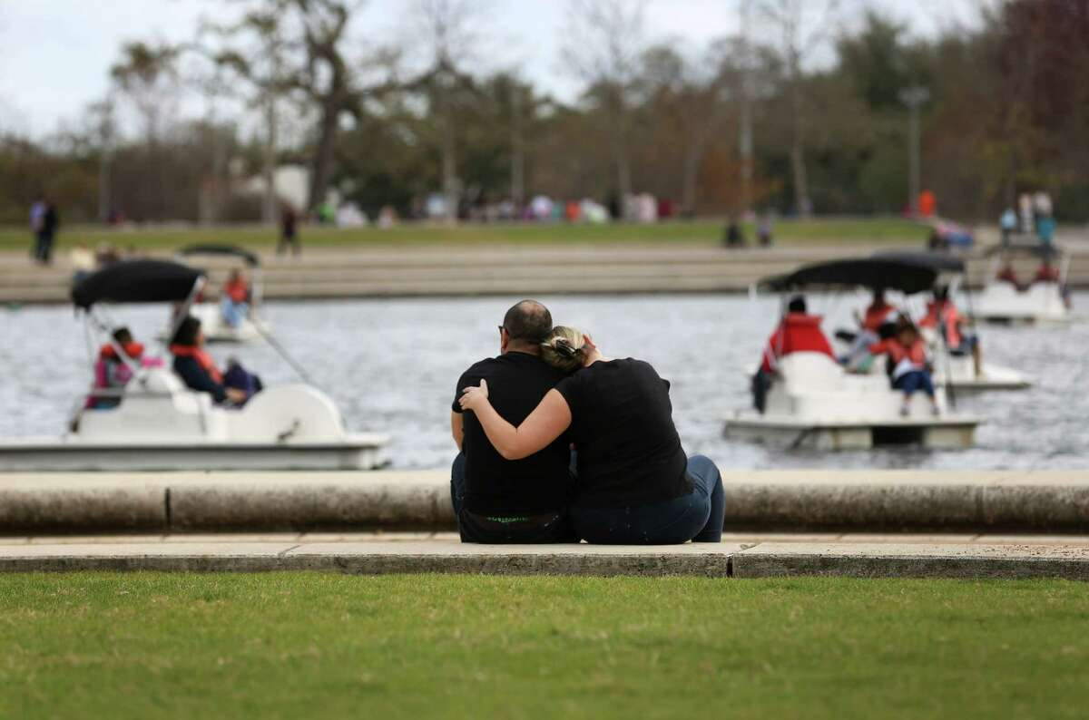 Erin Lattin, left, rests her head on the shoulder of her boyfriend, Rodrigo Rozas, as they sit by the water in Hermann Park Sunday, Feb. 14, 2016, in Houston. The couple recently celebrated their two-year anniversary, after meeting over 10 years ago in Chile.