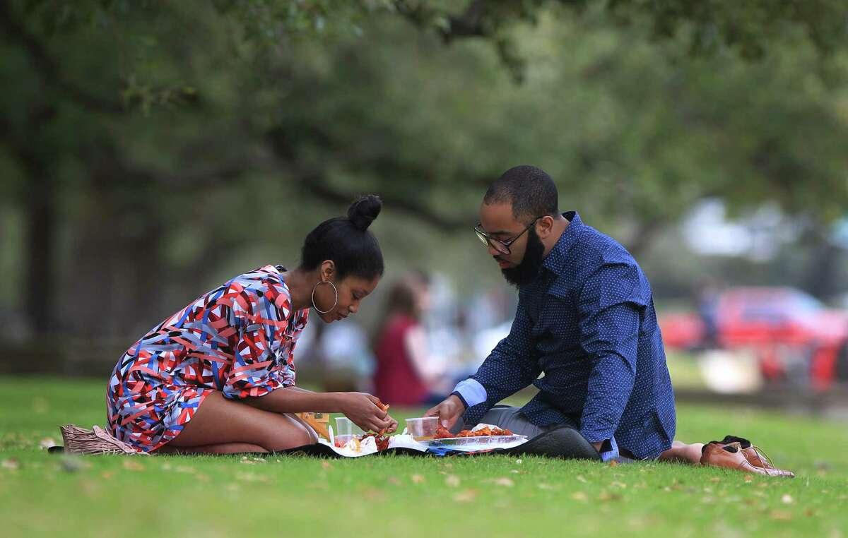 Brittany Tate, 28, and her boyfriend of over three years Zachary Scott eat crawfish in Hermann Park Sunday, Feb. 14, 2016, in Houston.