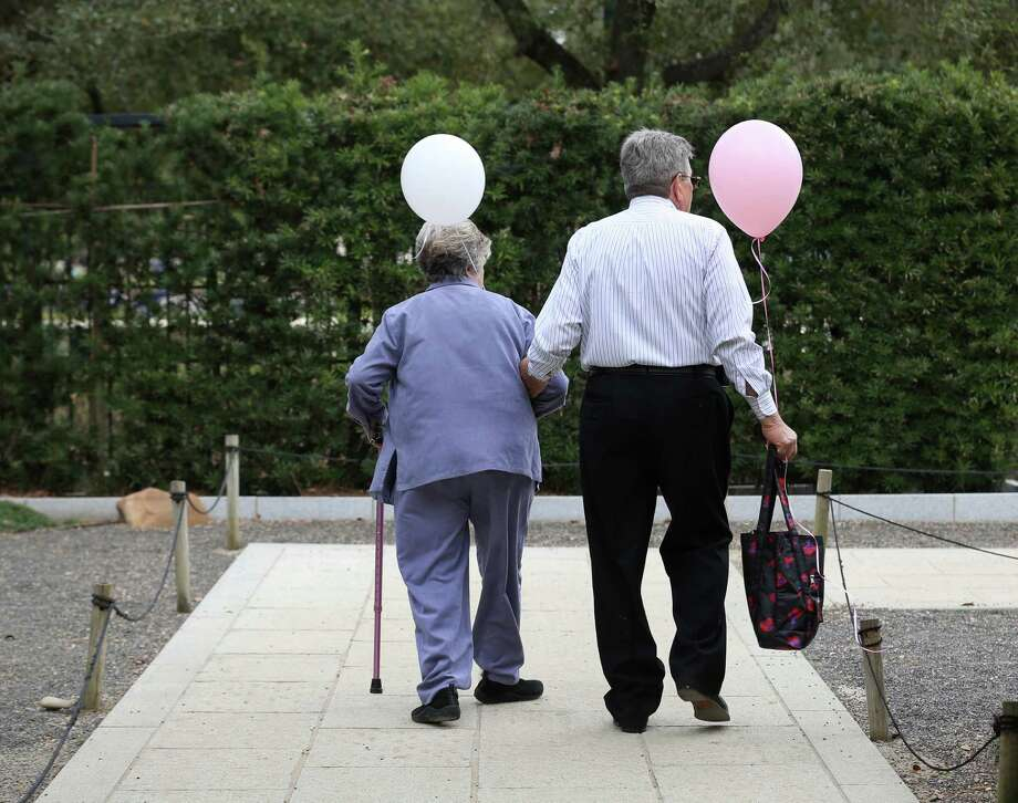 "Sherrye Coleman and her husband Larry walk through Hermann Park after celebrating their son's wedding Sunday, Feb. 14, 2016, in Houston. ""This year he planted me a rose garden, so I'll have them eternally,"" Sherrye said. Photo: Jon Shapley, Houston Chronicle / © 2015  Houston Chronicle"