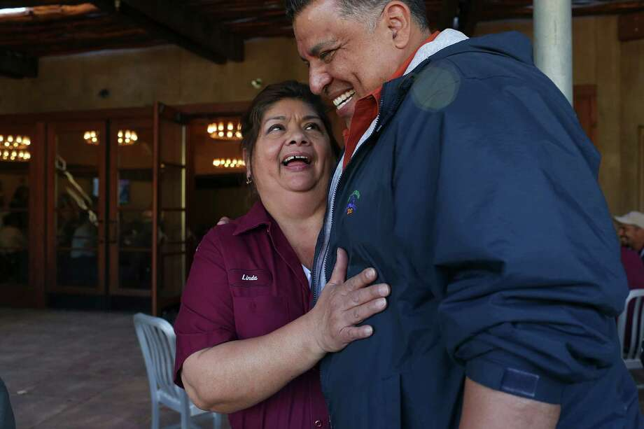 San Antonio Zoo employee Linda Alvarez is congratulated by Josef San Miguel, Director of Aviculture, after she was honored for her 40 years of service during a ceremony at the Zoo, Tuesday,  Feb. 9, 2016. Photo: Jerry Lara, Staff / San Antonio Express-News / © 2016 San Antonio Express-News