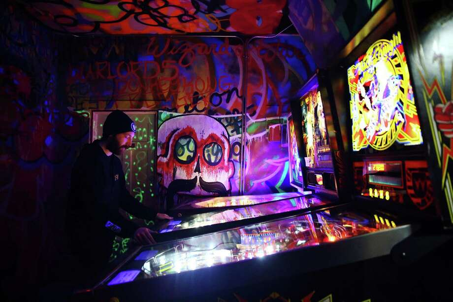 Travis Maisch plays in the semifinal round of the IFPA Washington State Pinball Championships, Saturday, Feb. 13, 2016 at 8-Bit Arcade in Renton.  Sixteen of the state's best players competed for the title and a trip to Las Vegas for the national championships. Photo: GENNA MARTIN, SEATTLEPI.COM / SEATTLEPI.COM