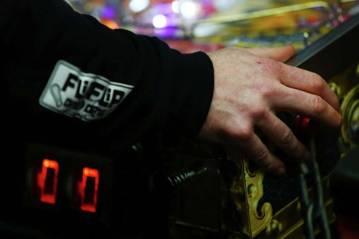 Travis Maisch plays in the semifinal round of the IFPA Washington State Pinball Championships, Saturday, Feb. 13, 2016 at 8-Bit Arcade in Renton. Sixteen of the state's best players competed for the title and a trip to Las Vegas for the national championships.