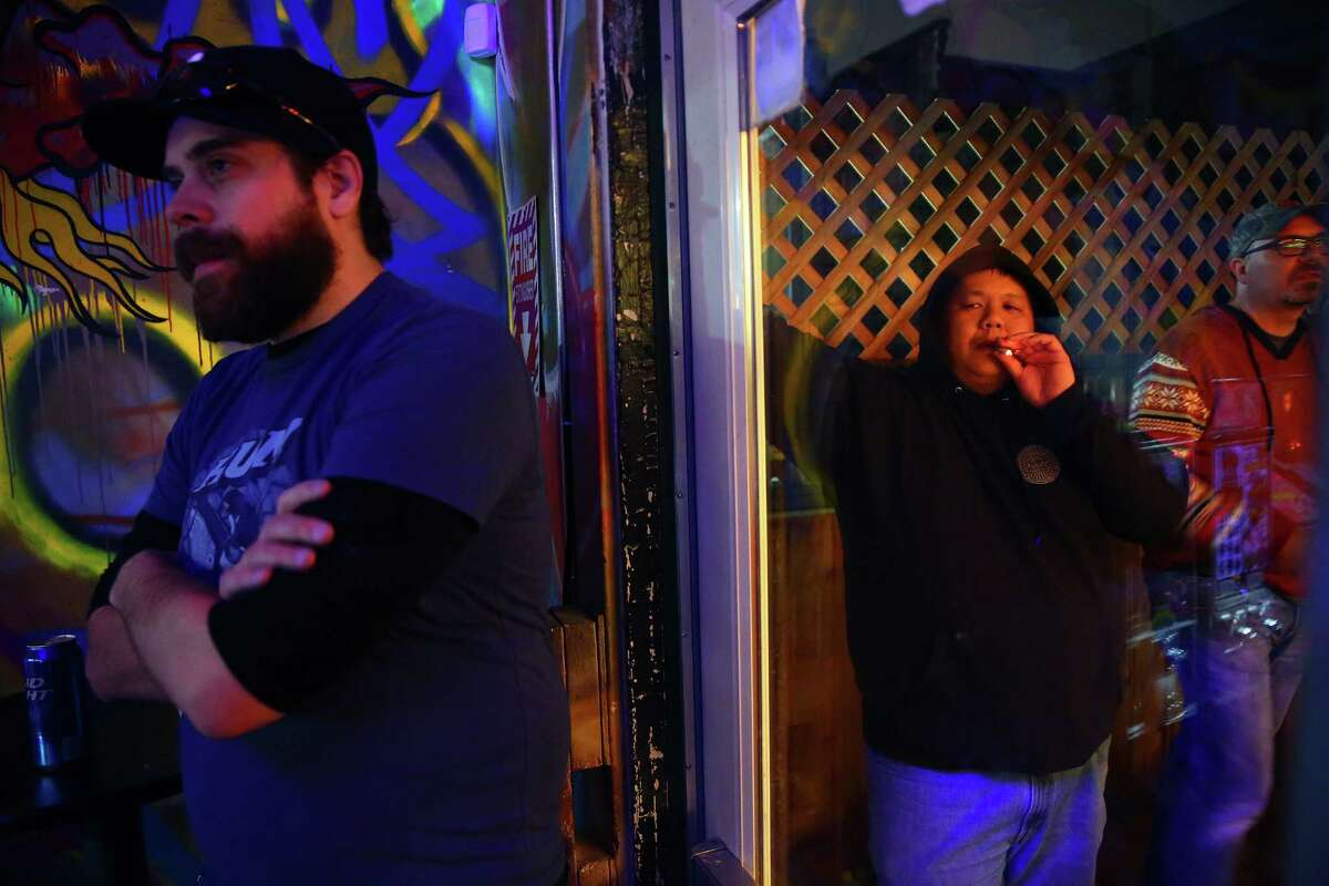 Chris Chinn (center) watches from outside as his opponent Travis Maisch plays in the semifinal round of the IFPA Washington State Pinball Championships, Saturday, Feb. 13, 2016 at 8-Bit Arcade in Renton. Sixteen of the state's best players competed for the title and a trip to Las Vegas for the national championships.