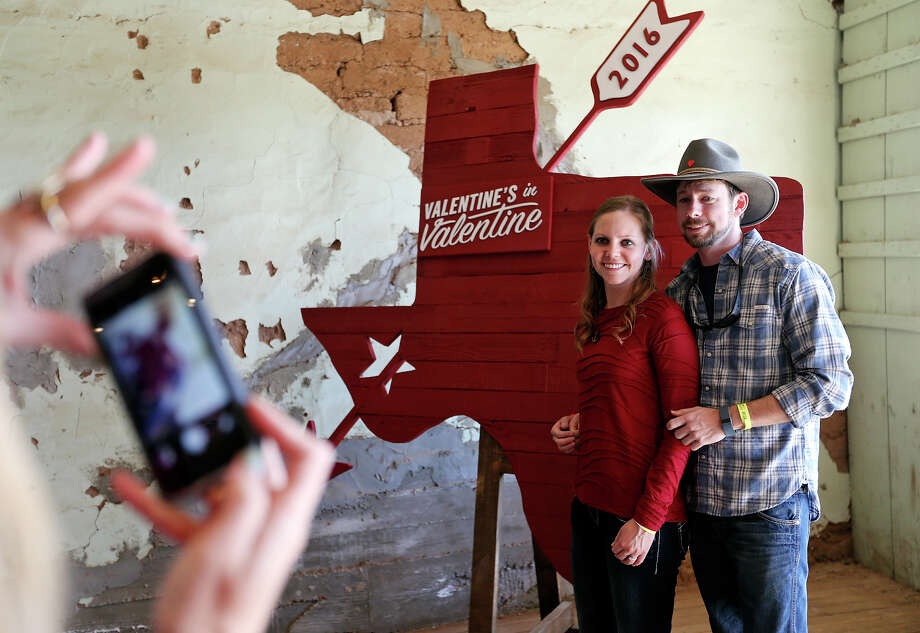 Allison Tidwell (left) and her fiancŽ Matthew Brown pose for photos during the 4th Annual Valentine's in Valentine festival Sunday Feb. 14, 2016 in Valentine, Tx.  Tidwell and Brown got engaged on Friday. Photo: Edward A. Ornelas, Staff / San Antonio Express-News / © 2016 San Antonio Express-News
