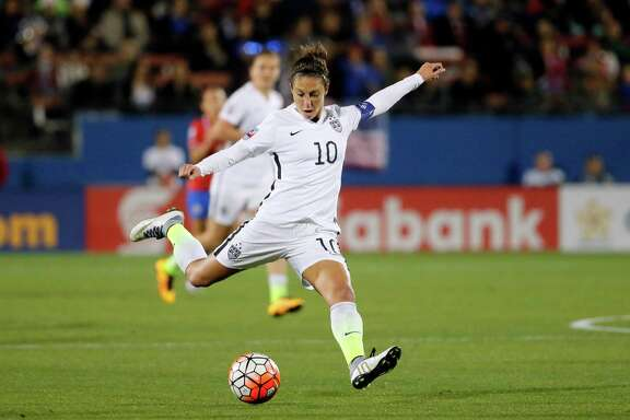 Carli Lloyd unleashes a shot during a CONCACAF Olympic qualifying match in Frisco. She is the national team's active scoring leader with 84 goals.
