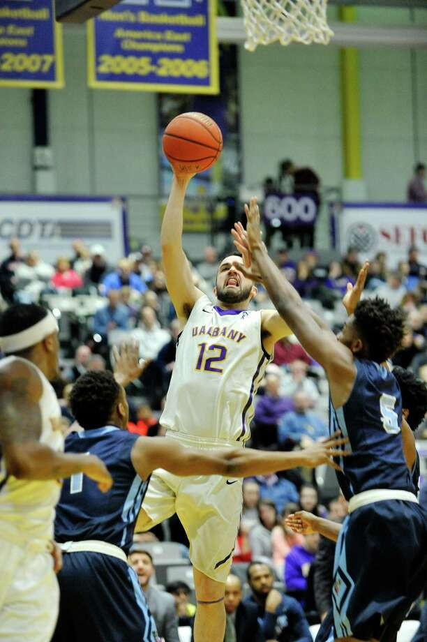 Peter Hooley of the UAlbany drives to the basket over  Maine players during their game on Sunday, Feb. 14, 2016, in Albany, N.Y.  (Paul Buckowski / Times Union) Photo: PAUL BUCKOWSKI / 10035422A