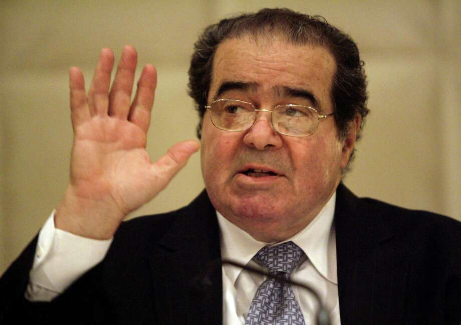 Supreme Court Justice Antonin Scalia speaks to the State Bar of Texas at its annual meeting in Dallas in a June 2009 file image. Photo: Mona Reeder /Dallas Morning News /TNS / Dallas Morning News