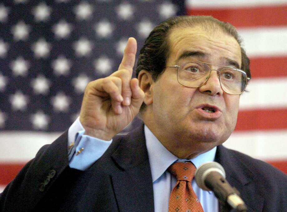 Because of his immense influence, intellectual clout and long cultural shadow, Justice Antonin Scalia's death in a presidential year promises to be a nightmare for the republic. Photo: Associated Press File Photo / The Hattiesburg American