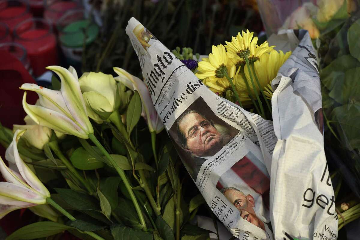 A makeshift memorial on Sunday pays tribute to Justice Antonin Scalia outside the Supreme Court.