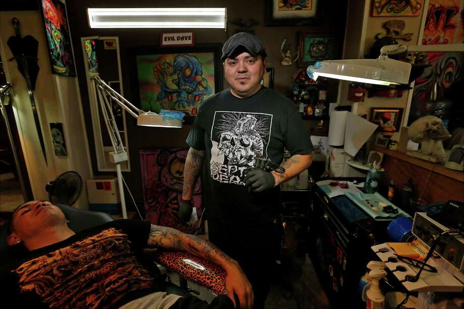 Evil Dave Gonzales' work can be found on the body or on canvas. Both can be seen at Calaveras Custom Tattoo in San Antonio. Photo: Kin Man Hui /San Antonio Express-News / ©2016 San Antonio Express-News