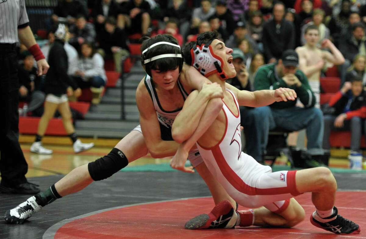 New Milford's Colin Linder and Masuk's Michael Fedorko wrestle in the 113 pound weight class championship match during the SWC high school wrestling championships, held at Masuk High School, on Saturday, February 13, 2016, in Monroe, Conn. Linder won the match.