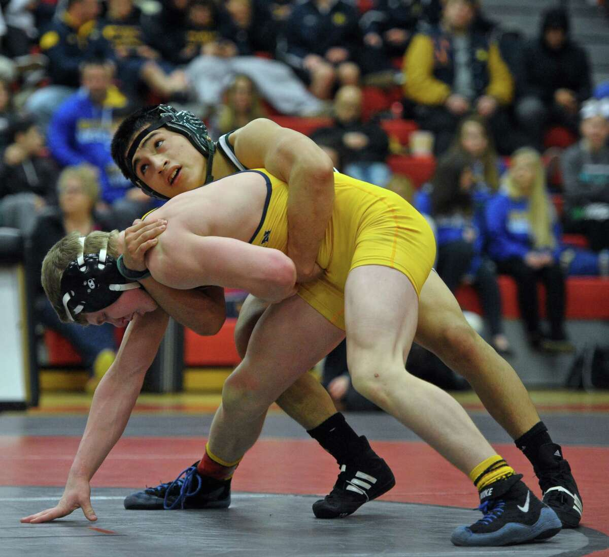 New Milford's Bryan Rojas and Newtown's Edward Lovely wrestle in the 145 pound weight class championship match during the SWC high school wrestling championships, held at Masuk High School, on Saturday, February 13, 2016, in Monroe, Conn. Rojas won the match.