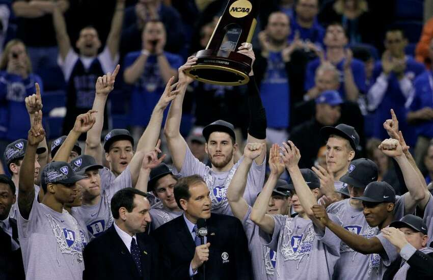 Duke players celebrate with the championship trophy after their 61-59 win over Butler in the men's NCAA Final Four college basketball championship game Monday, April 5, 2010, in Indianapolis.
